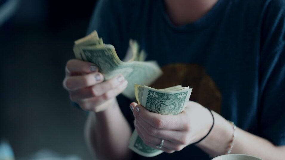 Counting Cash In a women's hand